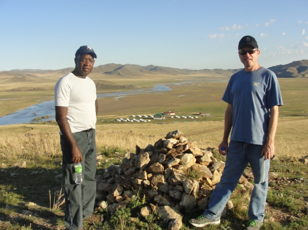 Dr. Gayle and Dr. Abram at the top of a mountain overlooking the ger camp.