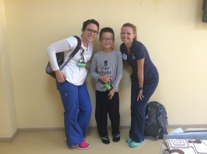 Sarah & Lindsay with a new inpatient child after a delivery of goodies!