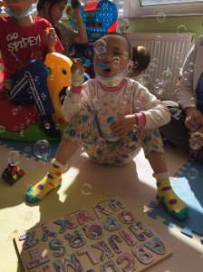Enjoying some bubbles and practicing deep breathing in the playroom. Bubbles are a great way to provide distraction and get any patient to focus on their breathing during painful procedures.